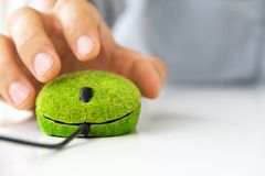 Eco computer mouse. Hand holding Eco computer mouse Stock Photos