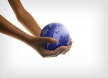 Eco concept. With hands and planet Stock Photography