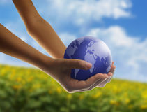 Eco concept. With hands and planet Royalty Free Stock Photos