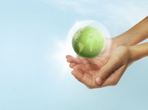 Eco concept. With hands and planet Royalty Free Stock Image