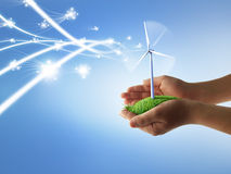 Eco concept. With hands and wind turbines Royalty Free Stock Image