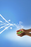 Eco concept. With hands and wind turbines Royalty Free Stock Images