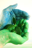 Eco concept. Blue and green hand Royalty Free Stock Photo