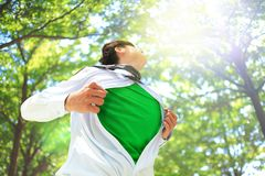 ECO concept. Business man opens his shirt to show off his green copy space in forest trees Royalty Free Stock Photos