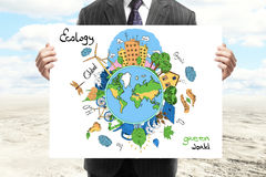 Eco concept. Businessperson in suit holding creative sketching of globe with natural healthy lifestyle icons on desert wall background. Eco concept Royalty Free Stock Images