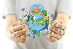 Eco concept. Casual man's hands holding creative sketching of globe with natural healthy lifestyle icons on light background. Eco concept Stock Photo