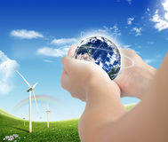 ECO Concept (globe and windmills) Royalty Free Stock Images