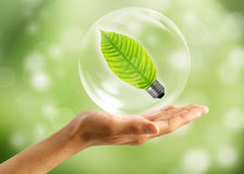 Eco concept : Hand with leaf in bubbles Stock Photos