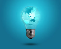 Eco concept: light bulbs with map inside stock images