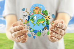 Eco concept. Male hands holding creative sketching of globe with natural healthy lifestyle icons on landscape background. Eco concept Royalty Free Stock Images