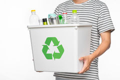 Eco concept. Male hands holding recycling bin full of recyclable. Items isolated on a white background Stock Photo