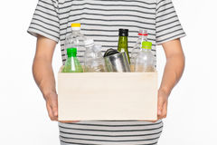 Eco concept. Male hands holding recycling bin full of recyclable Stock Photos