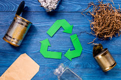 Eco concept with recycling symbol on blue table background top view Royalty Free Stock Photos