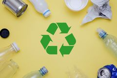 Eco concept with recycling symbol and garbage on table background top view. Eco concept with recycling symbol on table background top view Stock Photos