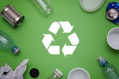 Eco concept with recycling symbol and garbage on table background top view. Eco concept with recycling symbol on table background top view Stock Photography