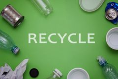 Eco concept with recycling symbol and garbage on table background top view. Eco concept with recycling symbol on table background top view Stock Photo
