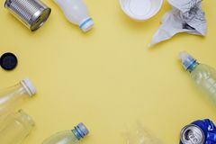 Eco concept with recycling symbol and garbage on table background top view. Eco concept with recycling symbol on table background top view Royalty Free Stock Photos
