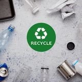 Eco concept with recycling symbol and garbage on table background top view. Eco concept with recycling symbol on table background top view Royalty Free Stock Photography