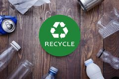 Eco concept with recycling symbol and garbage on table background top view. Eco concept with recycling symbol on table background top view Royalty Free Stock Photo