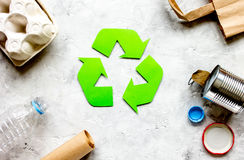 Eco concept with recycling symbol on table background top view Royalty Free Stock Photo
