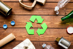 Eco concept with recycling symbol on table background top view. Eco concept with recycling symbol and garbage on wooden table background top view Stock Images
