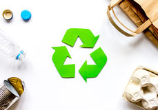 Eco concept with recycling symbol on table background top view mock up Royalty Free Stock Image