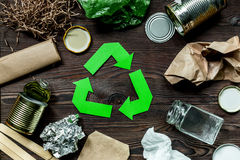 Eco concept with recycling symbol on wooden table background top view Stock Photos