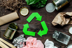 Eco concept with recycling symbol on wooden table background top view Royalty Free Stock Image