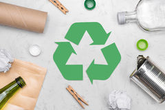 Eco concept. Waste recycling symbol with garbage on stone Stock Images