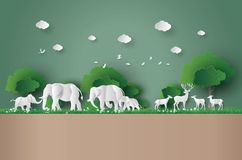 Eco concept and World Wildlife Day. With the elephant and deer in forest , Paper art and digital craft style Royalty Free Stock Photo