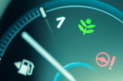 Eco drive light icon on car dashboard. Eco-driving concept royalty free stock photography