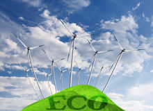Eco energy. Wind turbines on blue sky Stock Images