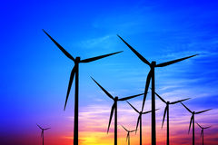Eco Energy. Wind turbines at sunset Royalty Free Stock Image