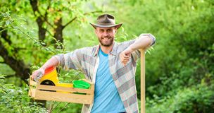 Eco farm worker. Harvest. sexy farmer hold shovel and box with pot. farming and agriculture. I love to work with plant. Garden equipment. happy earth day. Eco royalty free stock images
