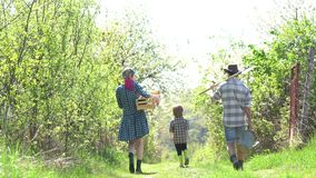 Eco farm workers. Earth day - Ecology concept. Happy farmer family having fun on spring field. Country life - Springtime stock footage