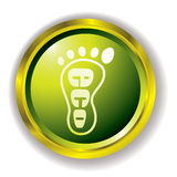 Eco foot icon. Green eco foot print icon with gold bevel and outer shadow Stock Photo