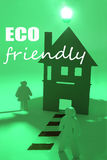 Eco-friendly. Wooden figures standing at a house using green energy royalty free stock image