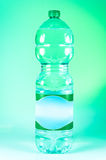 Eco friendly bottle. Green bottle made with recycled plastic RPET, eco friendly Stock Photos