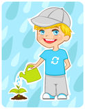 Eco-friendly boy water a plant Royalty Free Stock Images