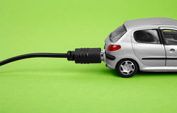 Eco-friendly car. Isolated on green background Stock Photography