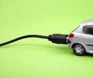 Eco-friendly car. Isolated on green background Royalty Free Stock Photo