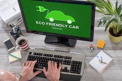 Eco friendly car concept on a computer. Man using a computer with eco friendly car concept on the screen Royalty Free Stock Photos