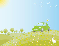 Eco-friendly car in a green field. In harmony with nature Royalty Free Stock Photography
