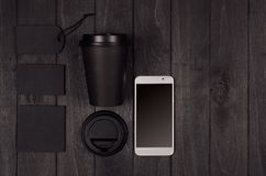 Eco friendly coffee template for design, advertising and branding - black paper cup, blank screen phone, label, card, cap, sugar. royalty free stock photos