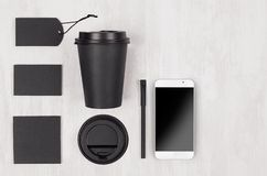 Eco friendly coffee template for design, advertising and branding - black paper cup, blank screen phone, label, card, cap, sugar. Eco friendly coffee template stock photos