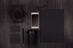 Eco friendly coffee template for design, advertising and branding - black paper cup, blank screen phone, label, card, decoration. stock photo