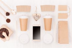 Eco friendly coffee template for design, advertising and branding - two brown paper cups, blank phone, label, packet, heart, beans royalty free stock image