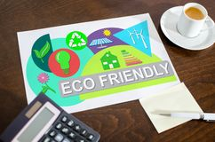 Eco friendly concept on a paper. Placed on a desk royalty free stock image