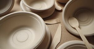 Eco-friendly disposable tableware. recycled paper dishes and wooden cutlery
