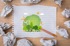 Eco friendly earth on note book paper with  pencil Royalty Free Stock Image